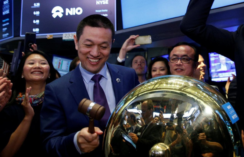 William Li rings a ceremonial bell as NIO's stock begins trading on the New York Stock Exchange (NYSE)